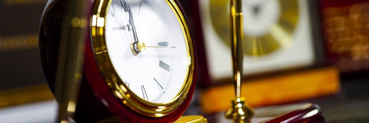 up close photo of clock pen executive award