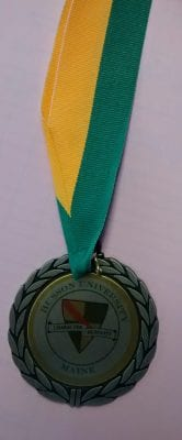 custom husson university medallion on a ribbon